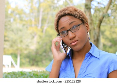 Professional Attractive African American Business Person With Black Hair Wearing Glasses Serious on the Phone