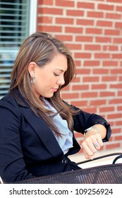 Professional and Attractive Brunette Business Woman Checking the Time