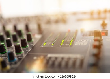Professional audio mixing console with faders and adjusting knobs,TV equipment Black and White selective focus - Image