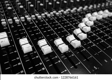 Professional Audio Sound Mixing Console Faders, black desk and white controller Faders