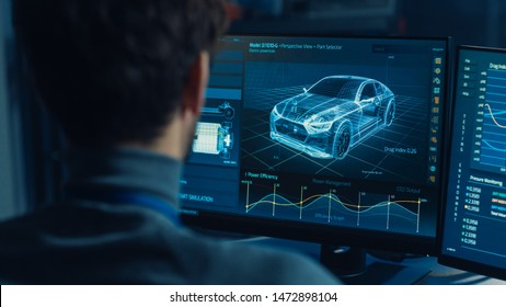 Professional Automotive Graphic Designer is Working on 3D CAD Software Rendering Electric Concept Car and Calculating its Efficiency in a High Tech Innovative Laboratory with a Prototype.