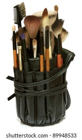 Professional bag with brushes on white, makeup tools. Studio shot