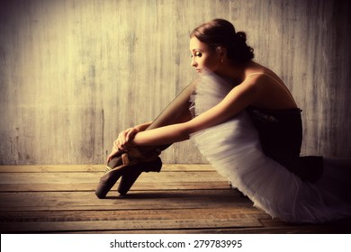 Professional ballet dancer resting after the performance. Art concept.