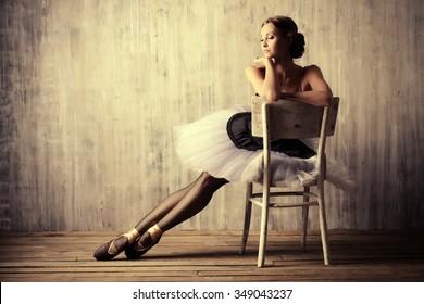 Professional ballet dancer resting after the performance. Art concept.
