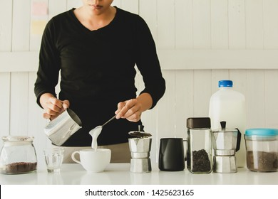 Professional of barista making hot coffee with equipment ,tool brewing on bar at kitchen home