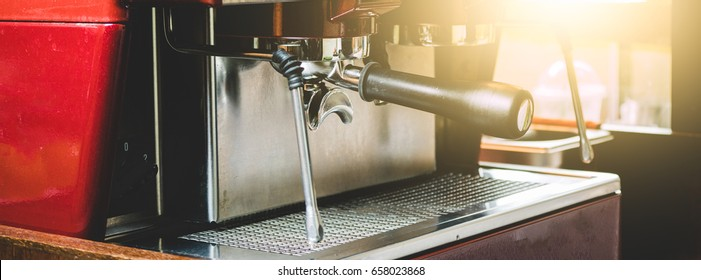 A professional Barista Use a coffee machine to BREW coffee at a customer order at The coffee shop is decorated in a retro style, with sunlight