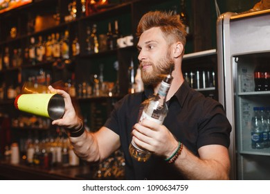 Professional bartender makes a show with a shaker