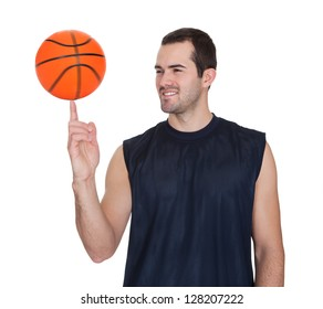 Professional basketball player spinning ball on his finger. Isolated on white