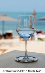 Professional beach restaurant serving with glasses and plates.Glass of water