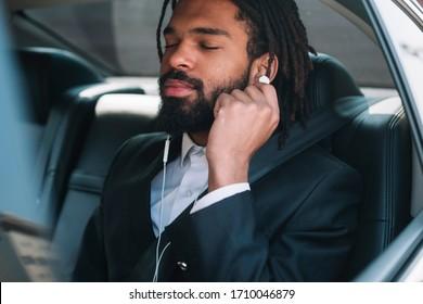 Professional black employee wearing headphones