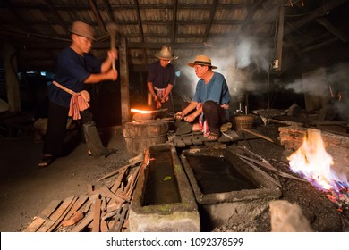 Professional Blacksmith at work is Hit the iron by a hot metal With fire,LAMPANG,THAILAND- 26 Mar 2018