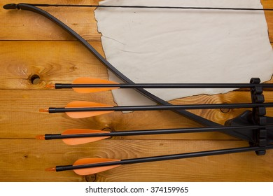 A professional bow with a set of arrows for hunting and sports.