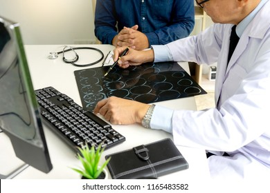 professional brain doctor give a counselor to the patient and tell the detail to help for good health, Stethoscope Medical instruments are on the table
