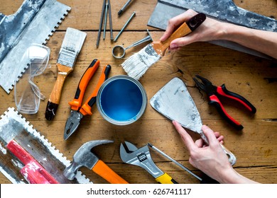 professional builder work with house renovation instruments on wooden background top view