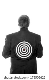 A Professional Business Man stands with a Target on his back. Representing Targeted Business Marketing, Stabbing someone in the back, Target Sales, and other concepts. The perfect image for your needs