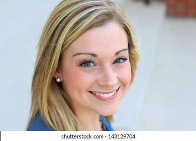 Professional Business Woman With Blond Hair Smiling and Looking At the Camera Copy Space Provided