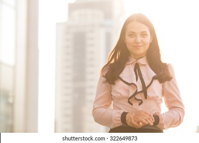 Professional business woman. Portrait of a business woman. Beautiful business woman on the background of the modern office. Business woman portrait outdoors with modern building as background.