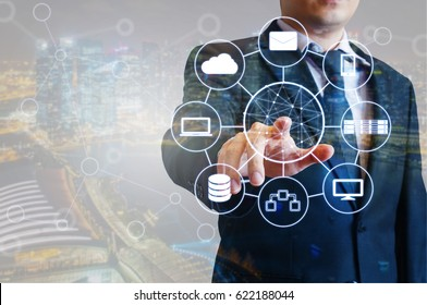 Professional businessman connected devices with world digital technology internet and wireless network on touch screen and city of business background in business and technology concept
