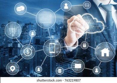 Professional businessman connecting cloud technology network and devices on hand in internet of things , technology , communication and business concept