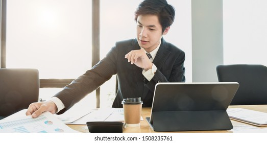 Professional businessman providing his investment strategy for the next meeting in his office room