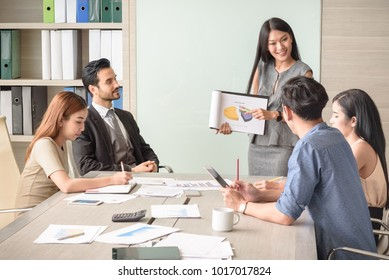 professional businesswoman present financial chart with team in the meeting