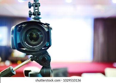 Professional camera with copy space at the conference room.Technical training of photography and filmmaking. Video camera.Meetings ,Seminars