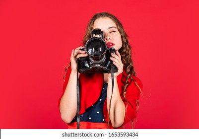 Professional camera. Girl with retro camera. Capture moments. SLR camera. Courses for photographers. Education for reporters and journalists. Learn use presets. Editing photos. Manual settings.