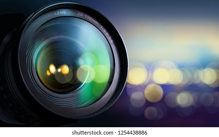 Professional camera lenses on night city background