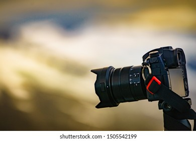 Professional camera taking picture film video outdoor on nature. Travel picture.