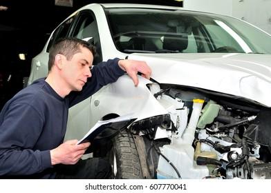 Professional car appraiser evaluate car damage.