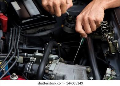 Professional car mechanic, auto repair concept.