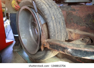 Professional car mechanic replace tire on wheel in auto repair service