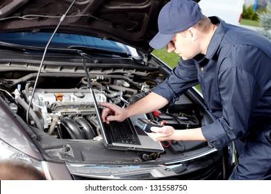 Professional car mechanic working in auto repair service.