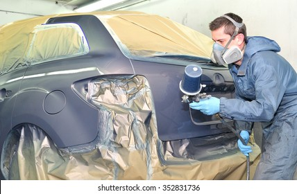 Professional car painting after body repair.