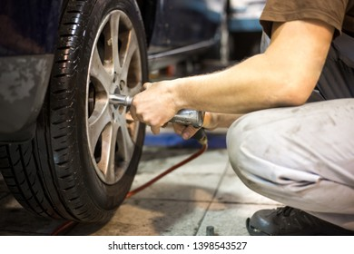 Professional car servis man changing the wheel of car