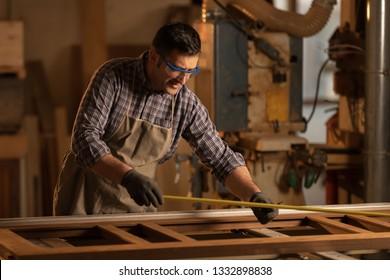 professional carpenter at work in his workshop