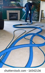 Professional carpet cleaner working on floors at a home
