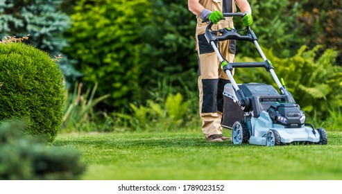 Professional Caucasian Gardener in His 40s Trimming Grass Lawn Using Modern Electric Cordless Mower. Landscaping Industry Theme. - Shutterstock ID 1789023152