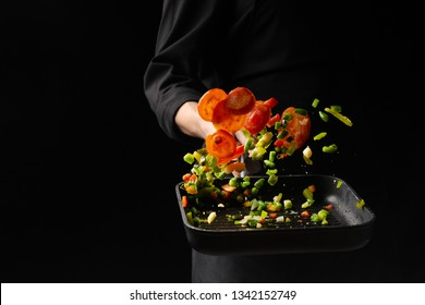 Professional chef. cooks vegetables in a pan, Asian cuisine. Oriental. background for the menu. recipe book
