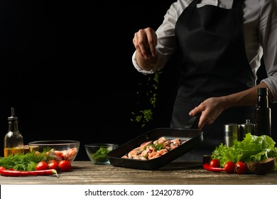 Professional chef sprinkles shrimps for salad, seafood and healthy food concept. Horizontal photo, menu, recipe book.