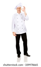 Professional chef in white hat with perfect sign