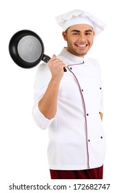 Professional chef in white uniform and hat, holding pan in his hands, isolated on white