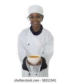 Professional chef in work-wear jacket serving soup isolatated on white
