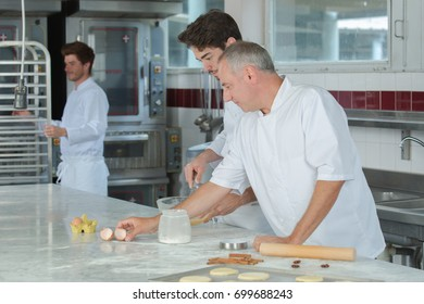 Professional chefs making pastry
