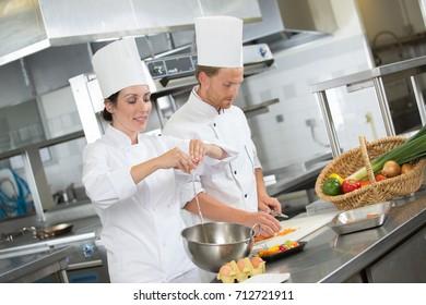 professional chefs prepare dish at restaurant