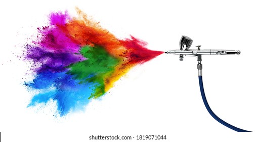 professional chrome metal airbrush acrylic color paint gun tool with colorful rainbow spray holi powder cloud explosion isolated on white panorama background industry art scale model modelling concept