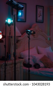 Professional cinema lamps with continuous light standing in the dark room.