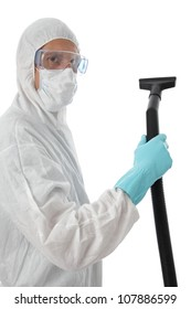 Professional cleaner in protective suit with safety goggles and mask about to start work with his vacuum to clean the interior of a building, isolated