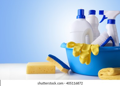 Professional cleaning equipment on white table and blue background overview. Cleaning tools company concept. Front view. Horizontal composition.