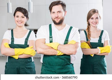 Professional cleaning team in uniforms